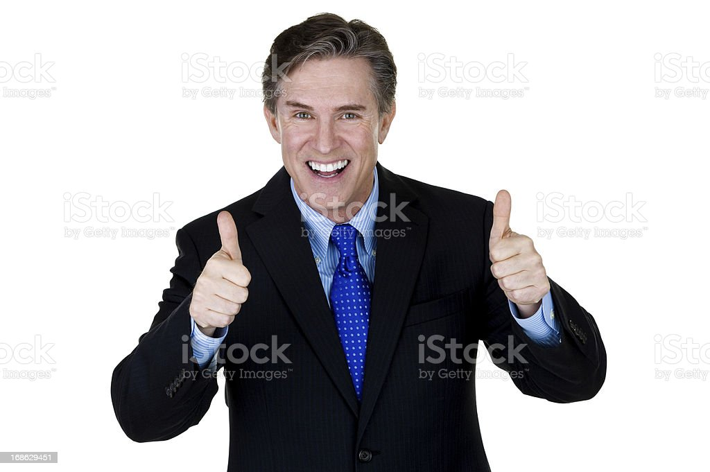 Excited businessman gesturing thumbs up stock photo
