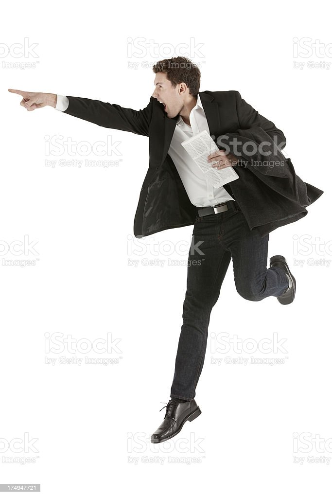 Excited businessman jumping and pointing royalty-free stock photo