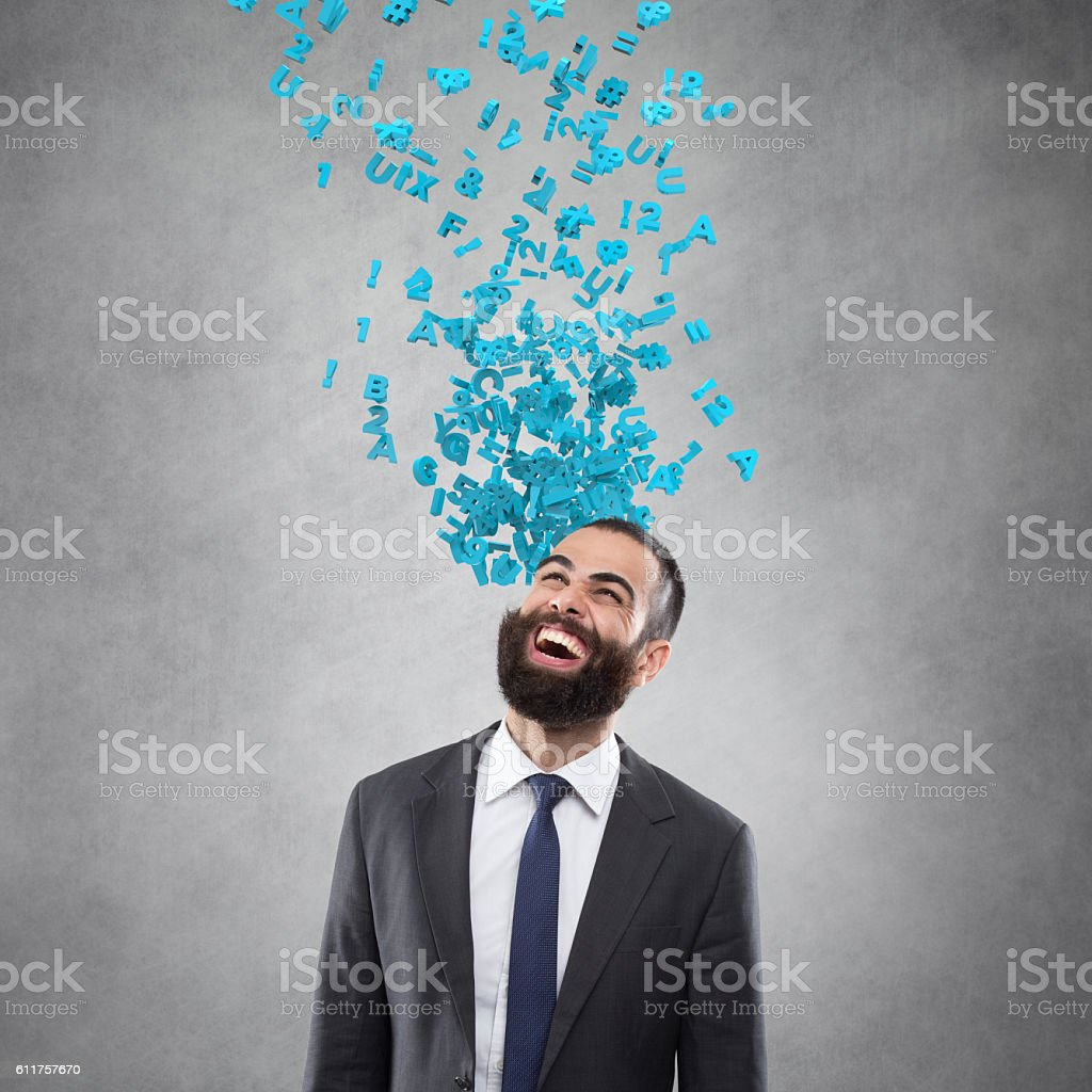 Excited Businessman looking up with flying alphabets stock photo