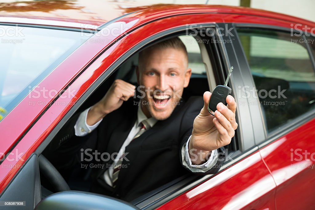 Excited Businessman Showing New Car Key stock photo