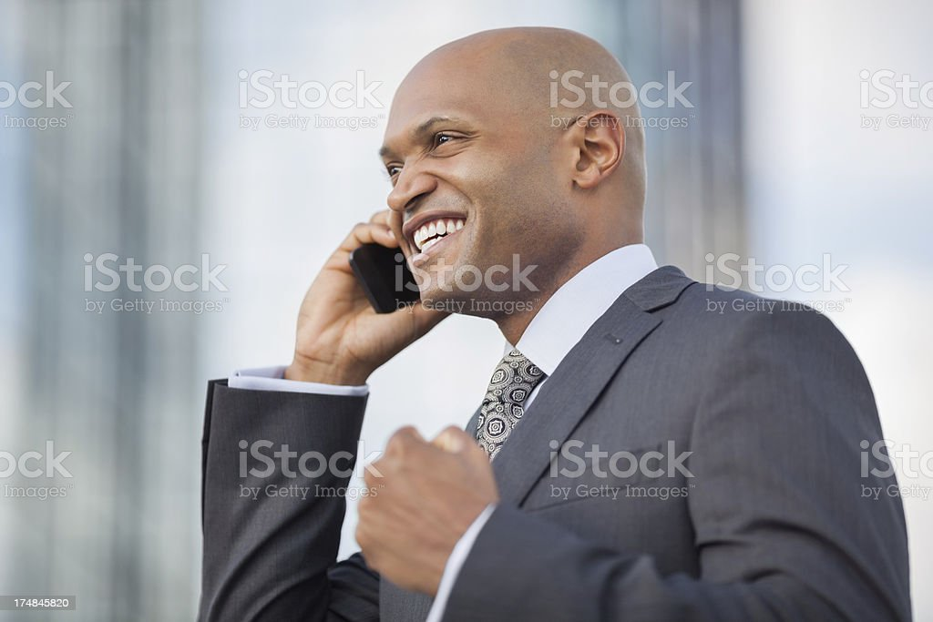 Excited Businessman Using Mobile Phone royalty-free stock photo