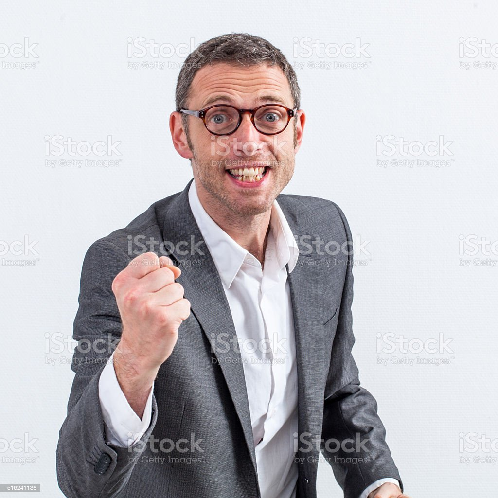 excited businessman with tensed fist fighting for success stock photo