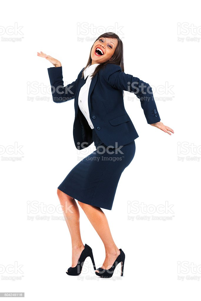 Excited businesswoman dancing stock photo
