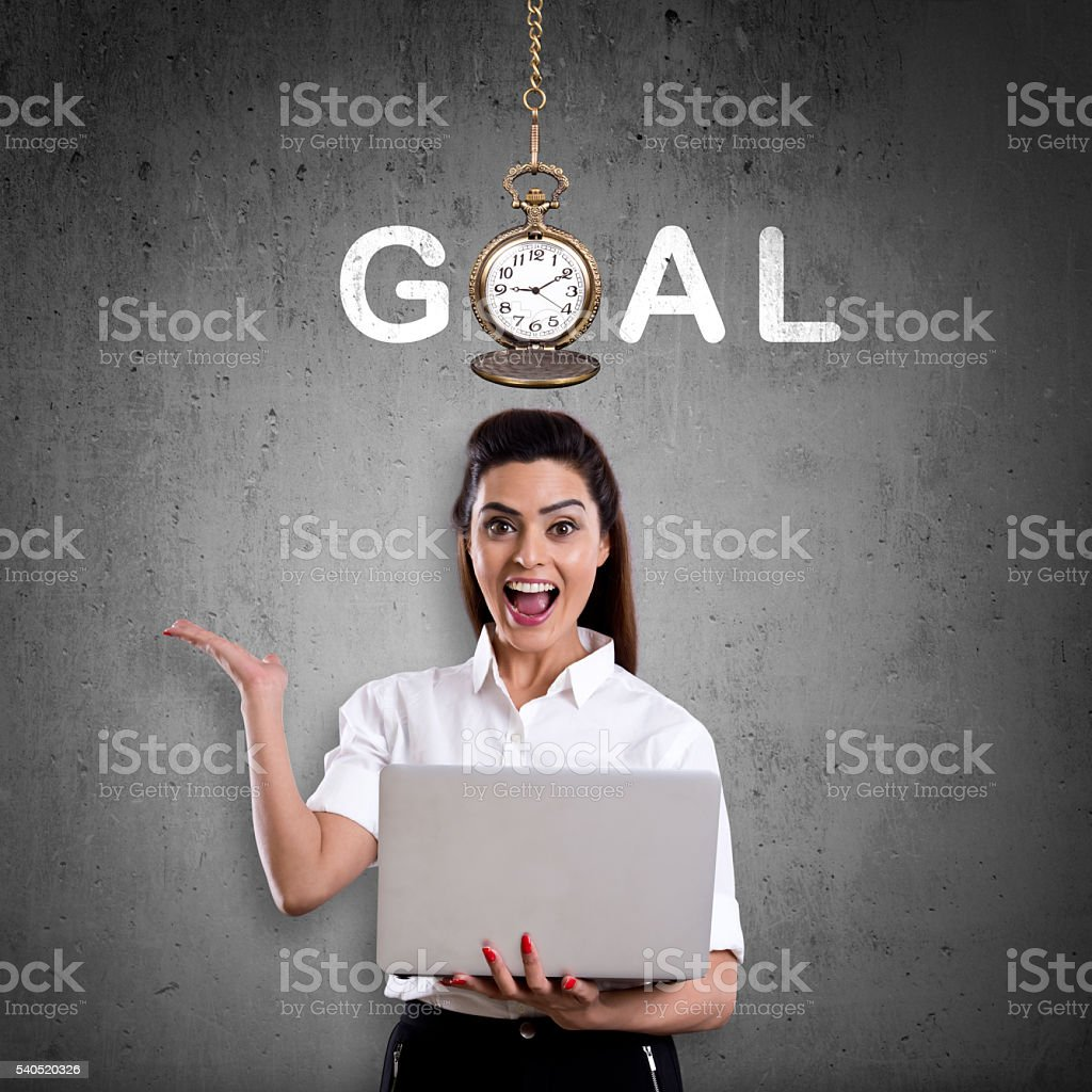 Excited businesswoman showing goal concept stock photo