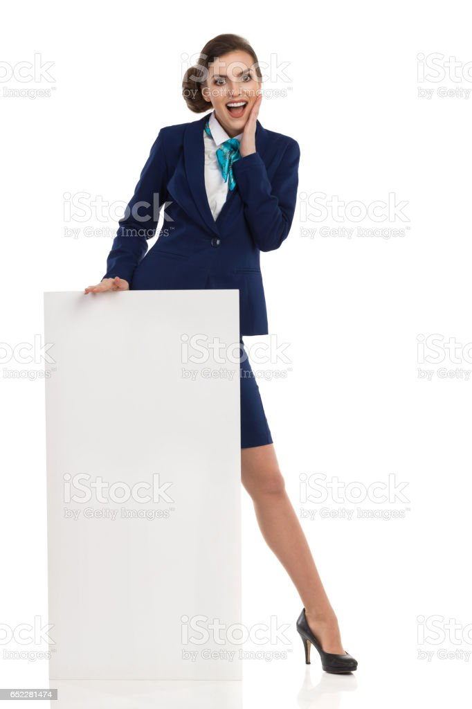Excited Businesswoman Standing Behind Placard stock photo