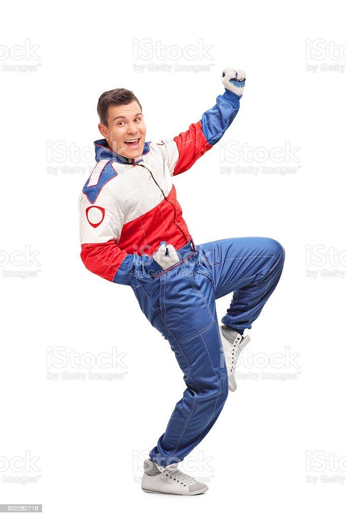 Excited car racer celebrating stock photo