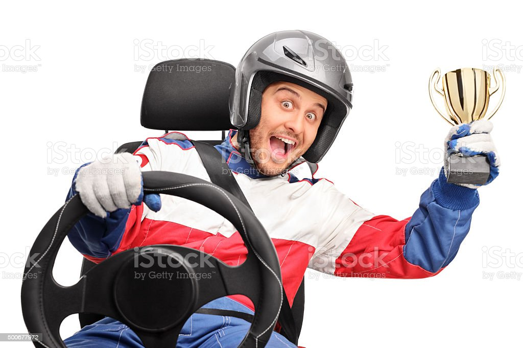 Excited car racer holding a trophy stock photo