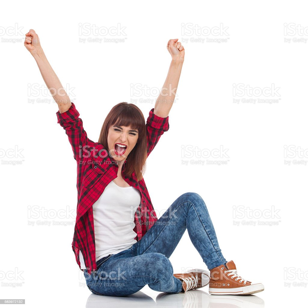 Excited Casual Woman Cheering stock photo