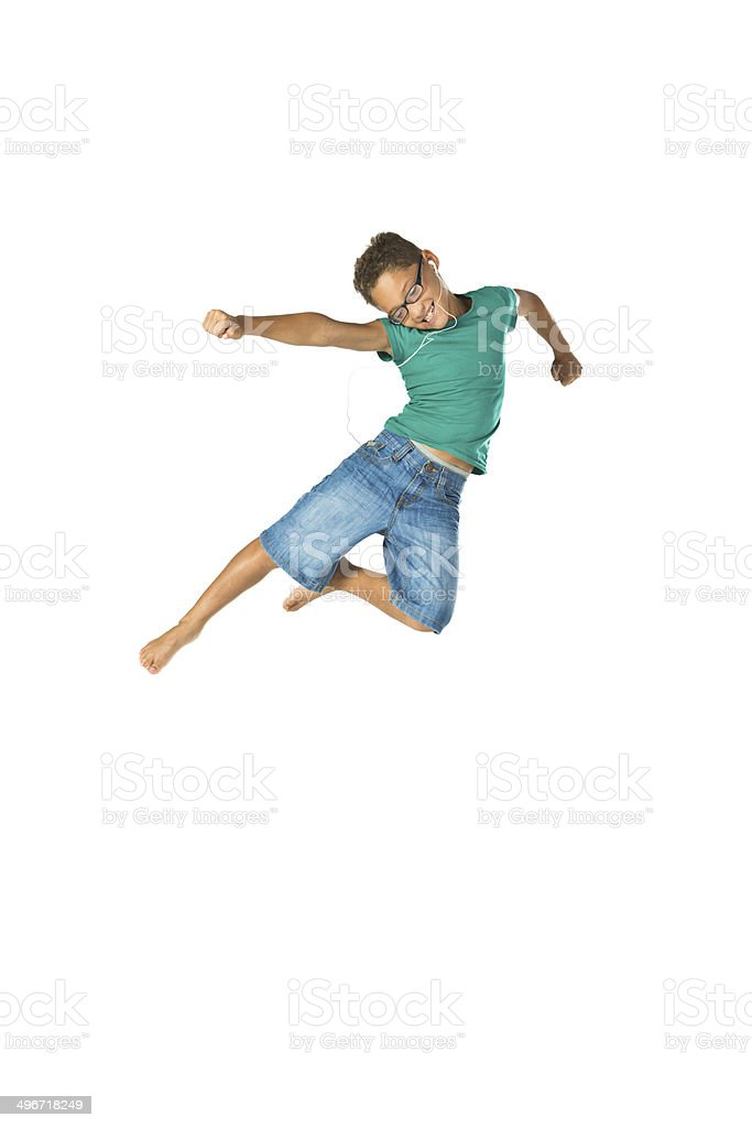 Excited child jumping in air stock photo