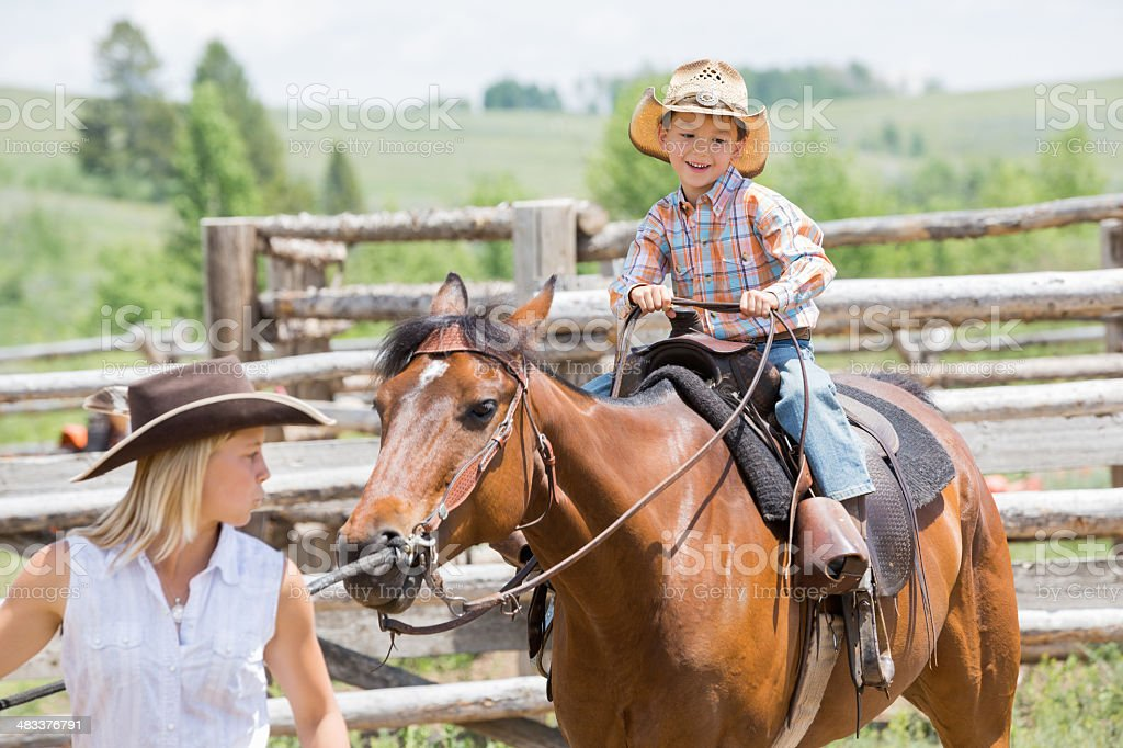 Excited  child riding horse during lesson at dude ranch royalty-free stock photo