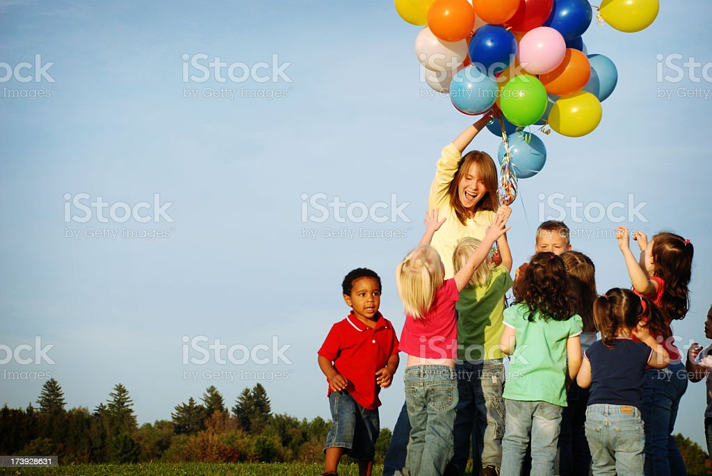 Excited Children Reaching for Balloons royalty-free stock photo