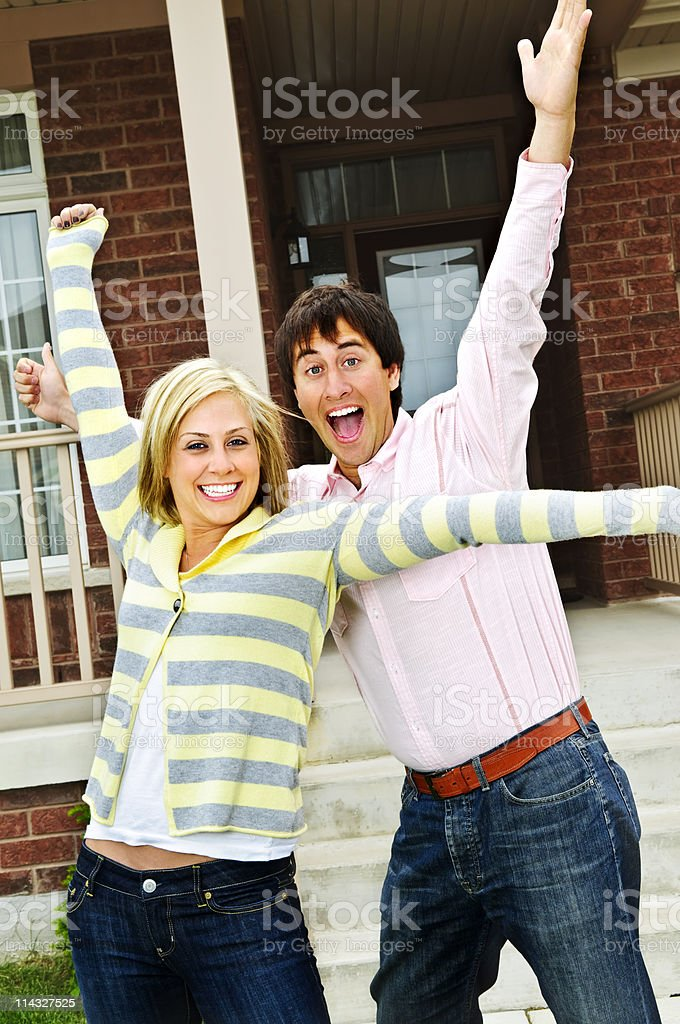Excited couple at home royalty-free stock photo