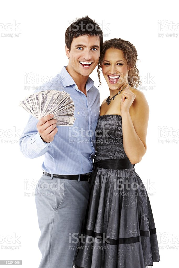 Excited couple holding money isolated over white royalty-free stock photo