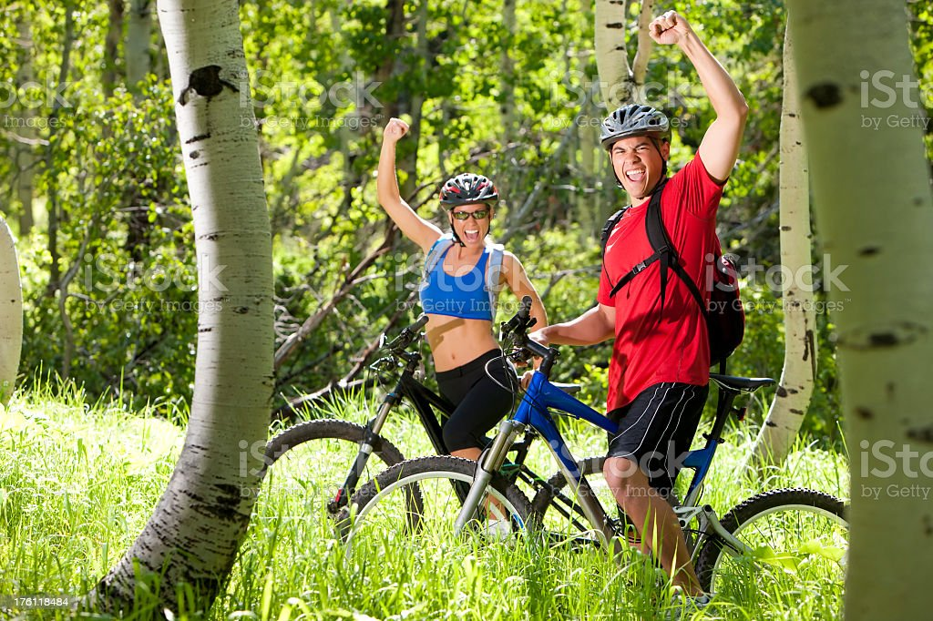 Excited Couple Mountain Biking royalty-free stock photo