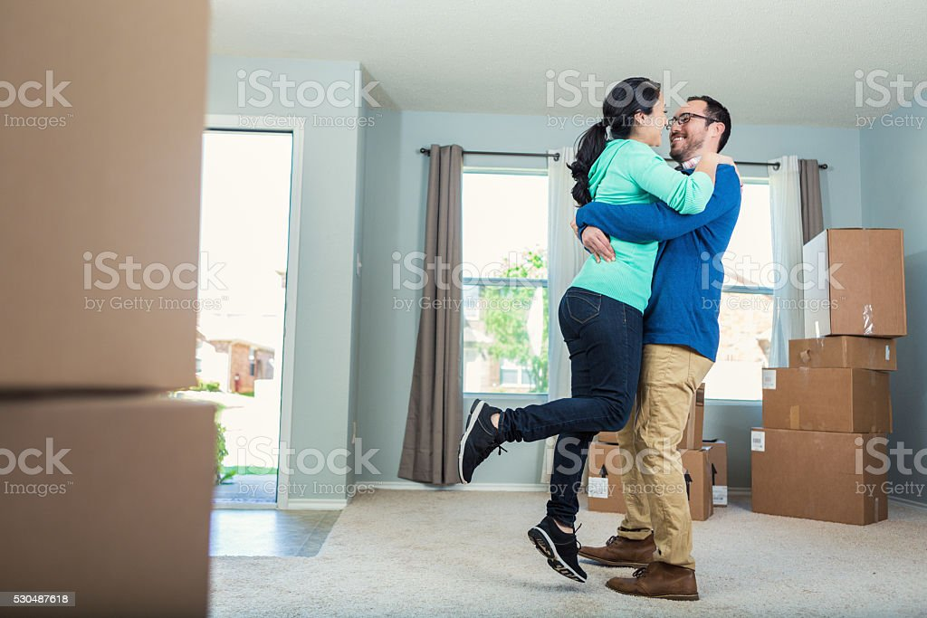 Excited couple move into new home stock photo