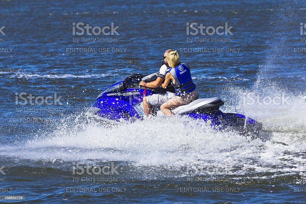 Excited couple riding jetski royalty-free stock photo