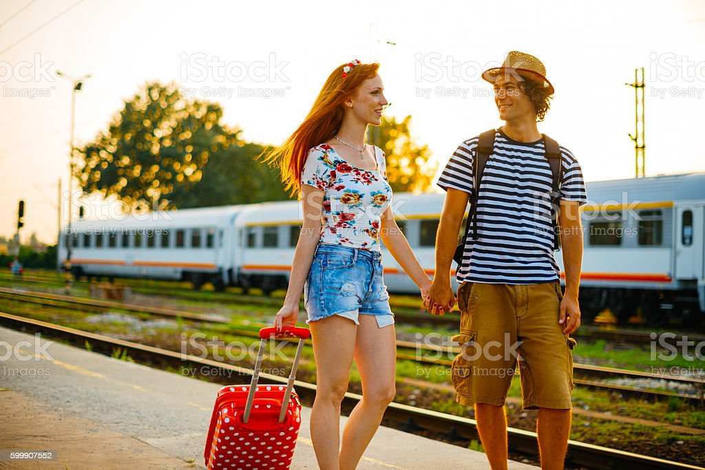 Portrait of beautiful redhead woman with handsome boyfriend in casual...