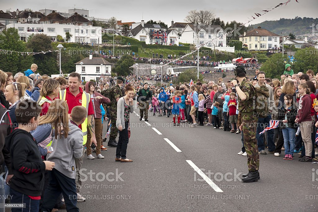 Excited crowds on Shaldon bridge waiting for Olympic flame procession royalty-free stock photo