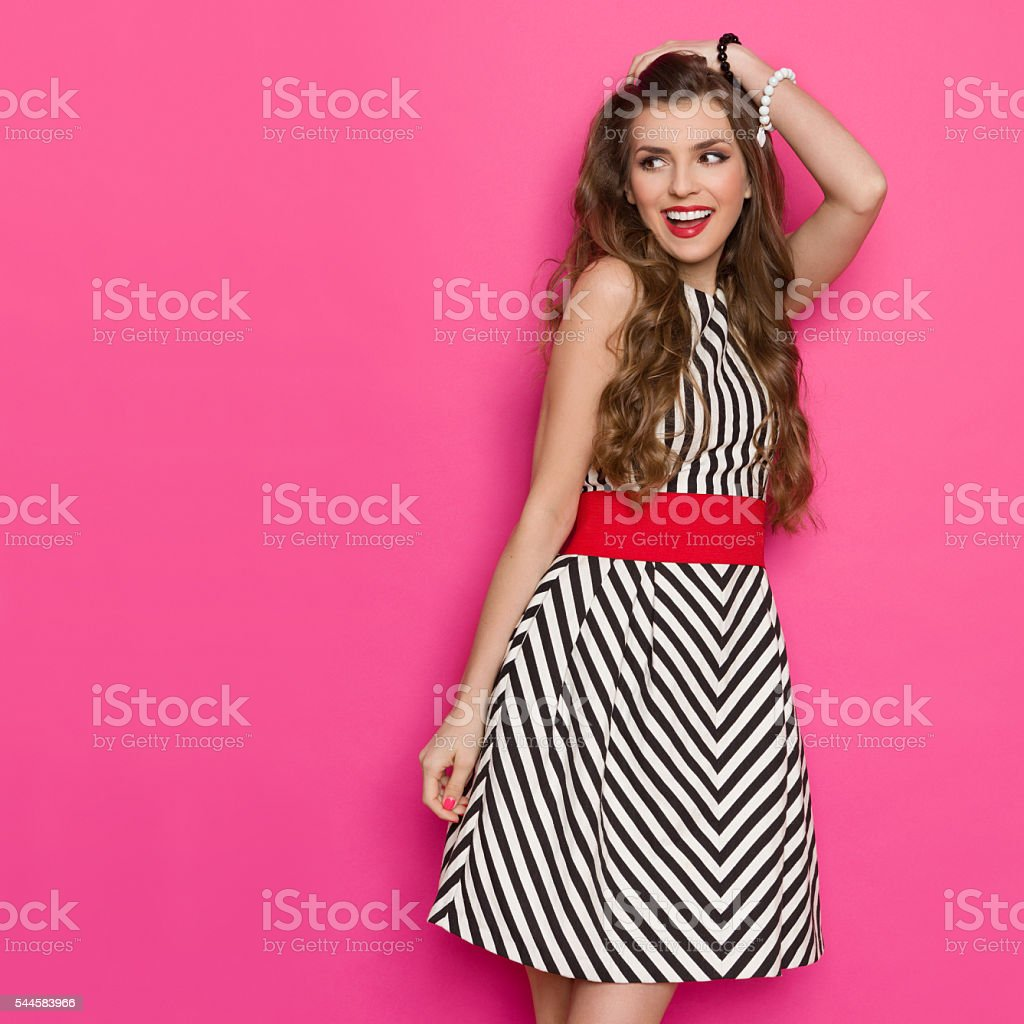 Excited Elegant Woman Laughing And Looking Away stock photo