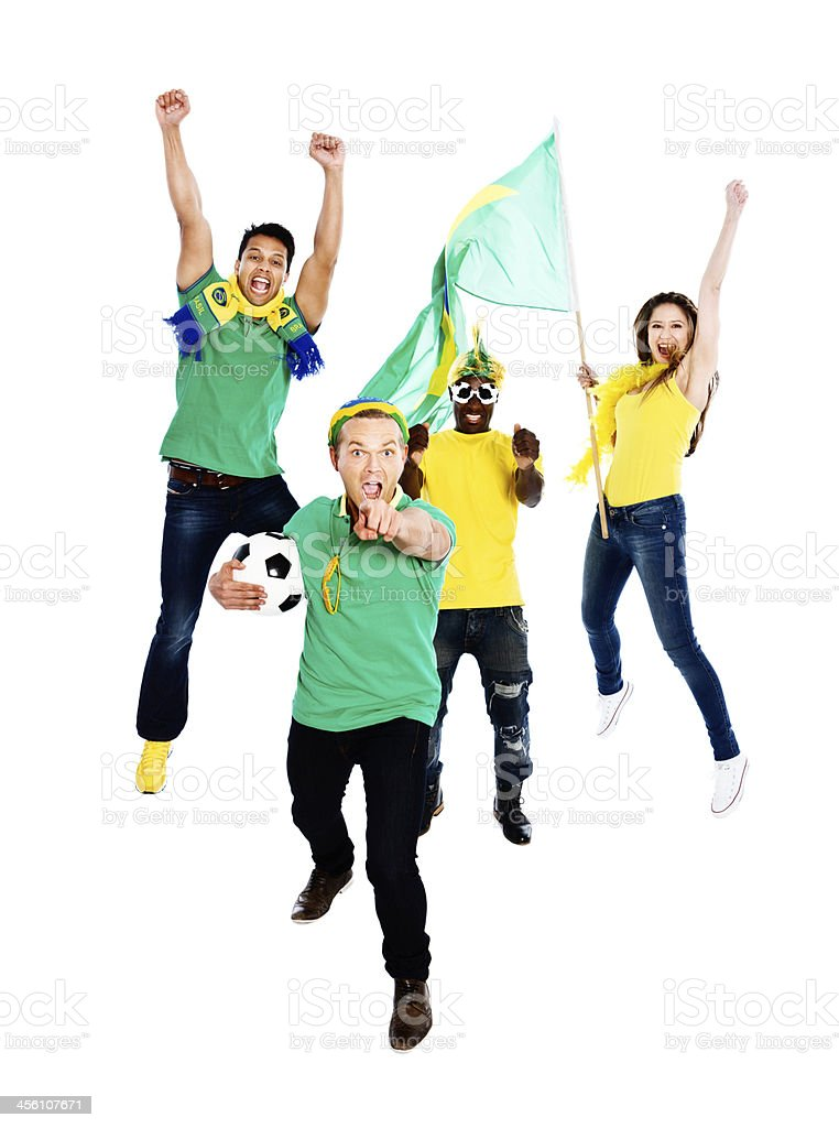Excited, exuberant Brazilian soccer fans jump for joy! royalty-free stock photo