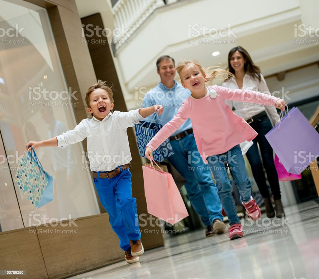 Excited family at the shopping center stock photo