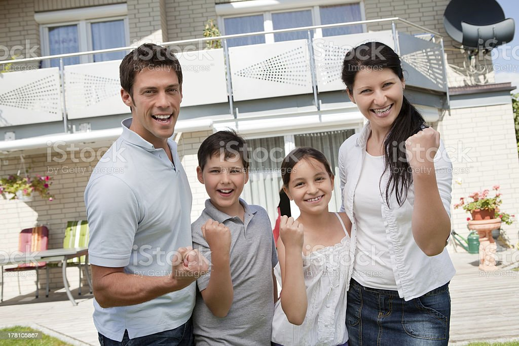 Excited family celebrating success royalty-free stock photo