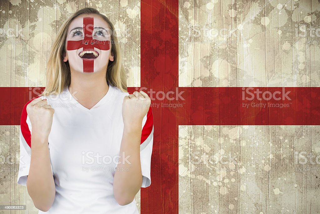 Excited fan england in face paint cheering stock photo