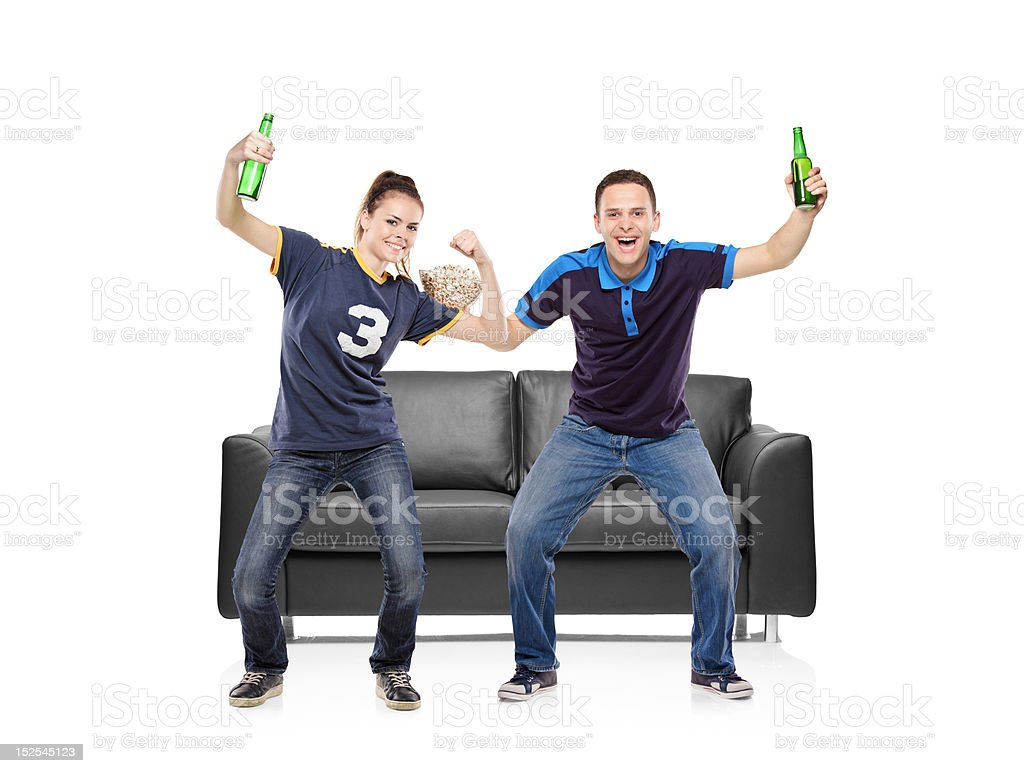 Excited fans, boy and girl watching sport royalty-free stock photo