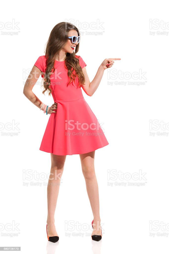 Excited Fashion Woman Pointing stock photo