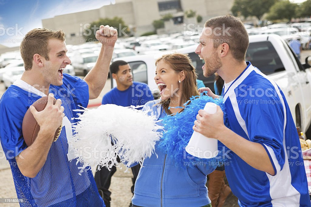 Excited football fans at a stadium tailgate party stock photo