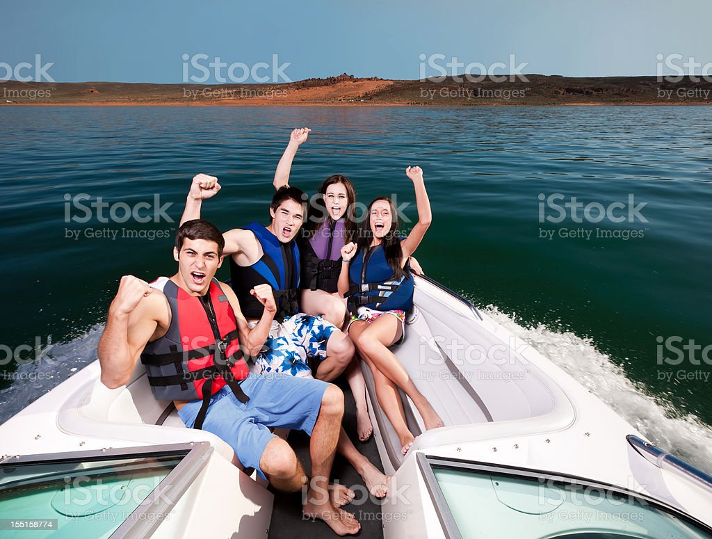 Excited Friends Boating stock photo