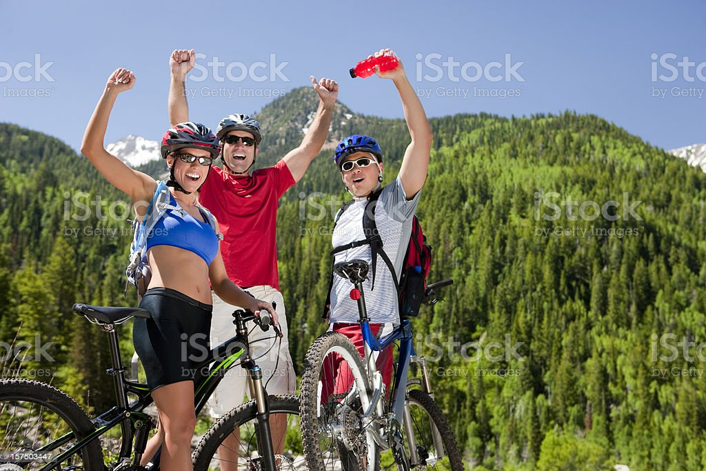 Excited Friends Mountain Biking Together royalty-free stock photo
