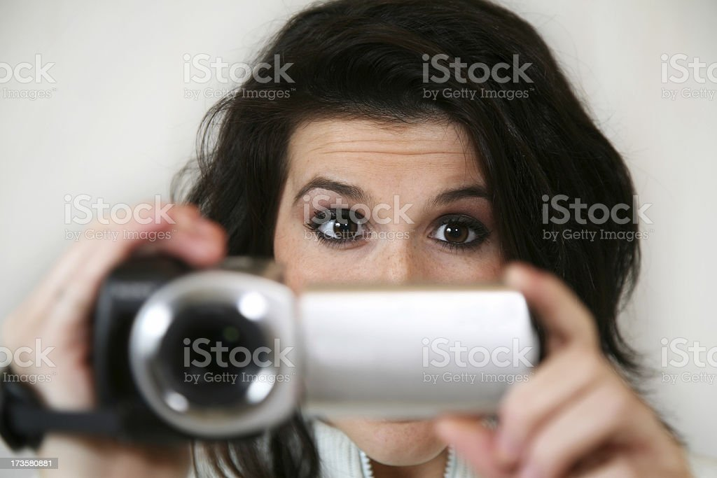 Excited Girl Figuring Out Her New Video Camera royalty-free stock photo