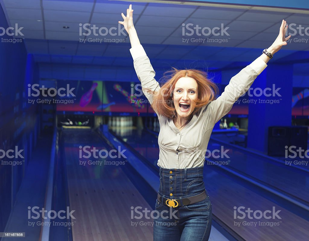 Excited girl in a bowling royalty-free stock photo
