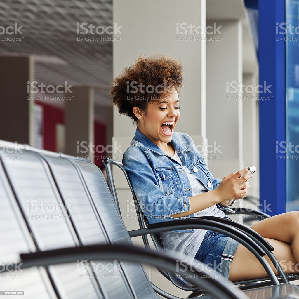 Excited girl in a waiting room royalty-free stock photo