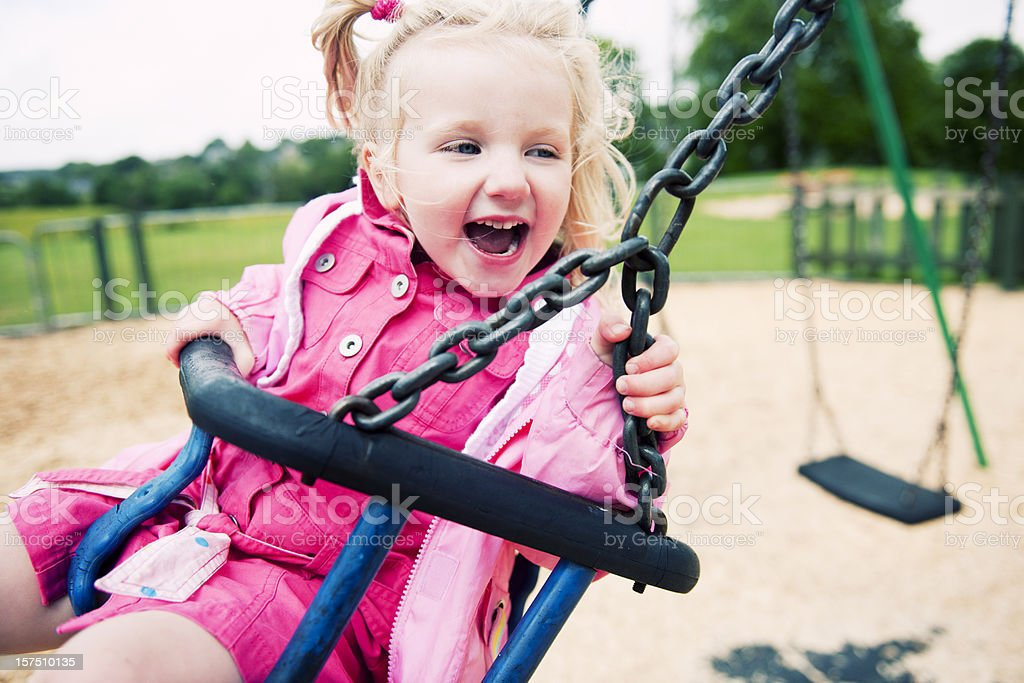 excited girl on a swing royalty-free stock photo