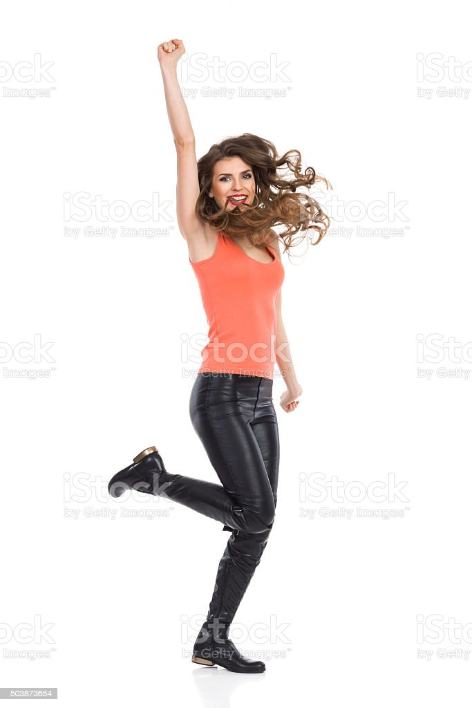 Excited Girl Punching The Air stock photo