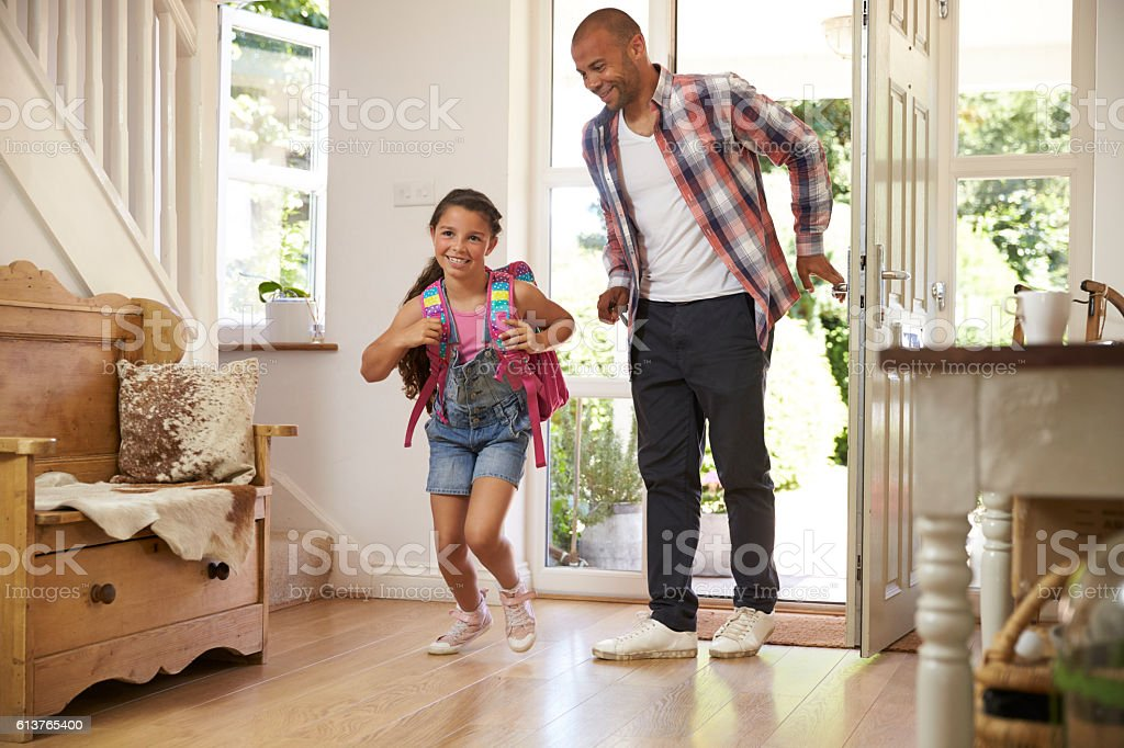 Excited Girl Returning Home From School With Mother stock photo