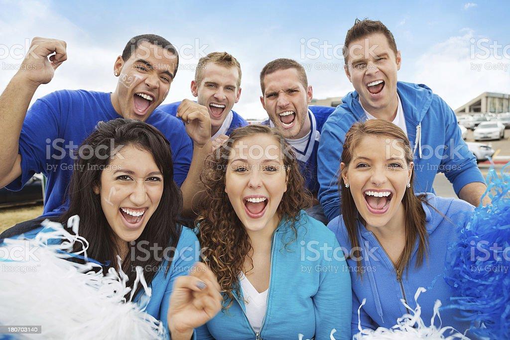 Excited group of sports fans celebrating at tailgate party royalty-free stock photo