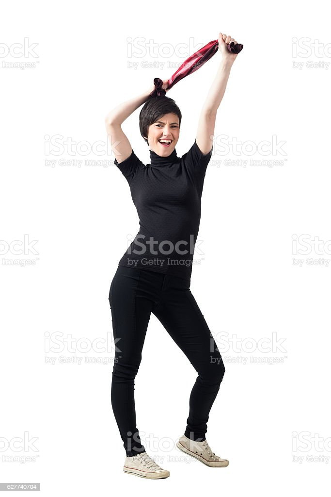 Excited happy brunette woman stretching shawl over her head stock photo