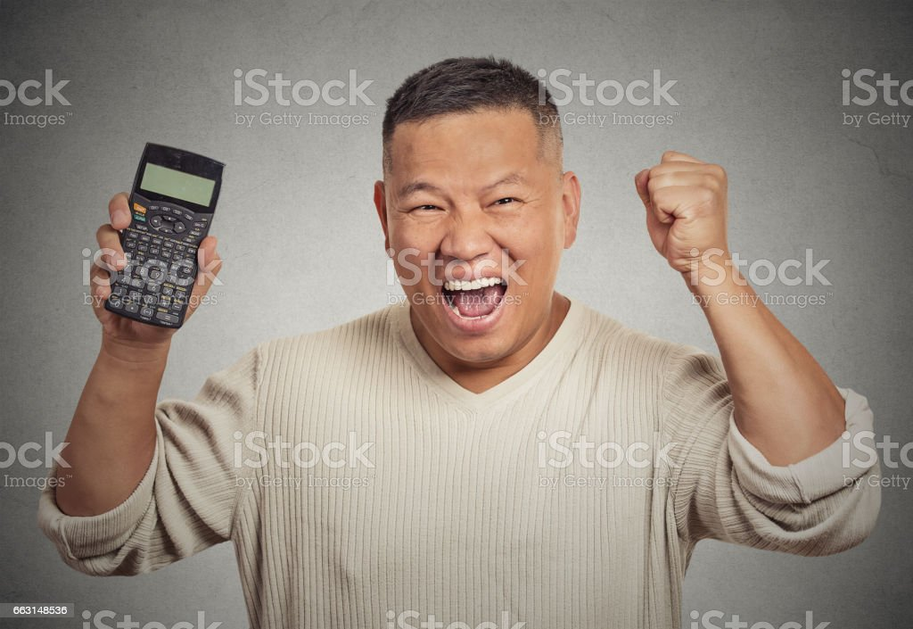Excited happy business man person showing calculator with million number sign stock photo