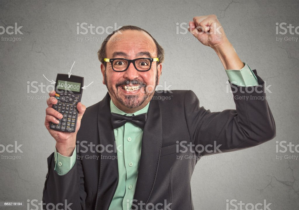 Excited happy businessman showing calculator with million number sign on screen stock photo