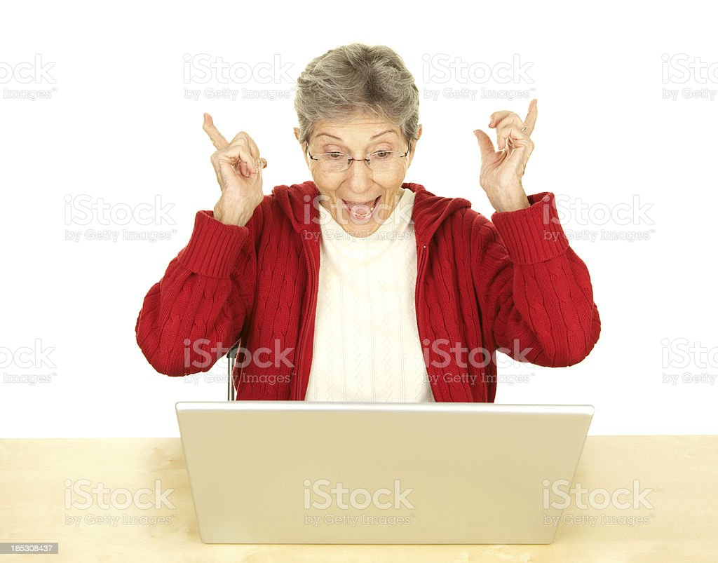 Excited Happy Senior Woman Looking at Laptop Computer royalty-free stock photo