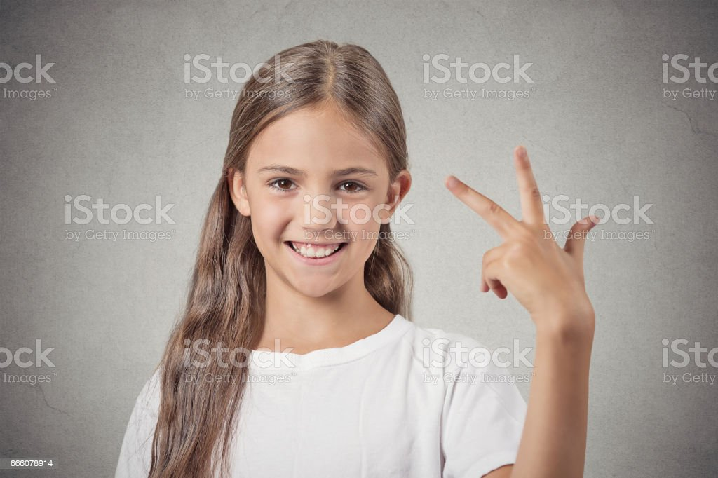 excited, happy successful teenager girl giving finger signs stock photo