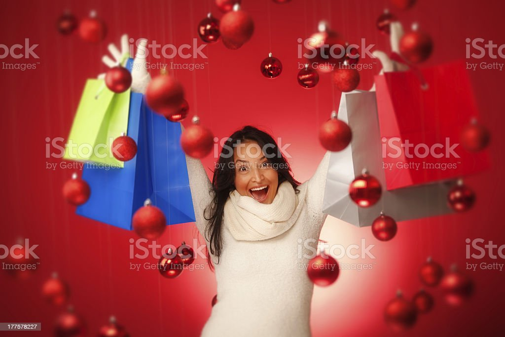 Excited Hispanic Woman Model Christmas Shopper with Shopping Bag Hz royalty-free stock photo