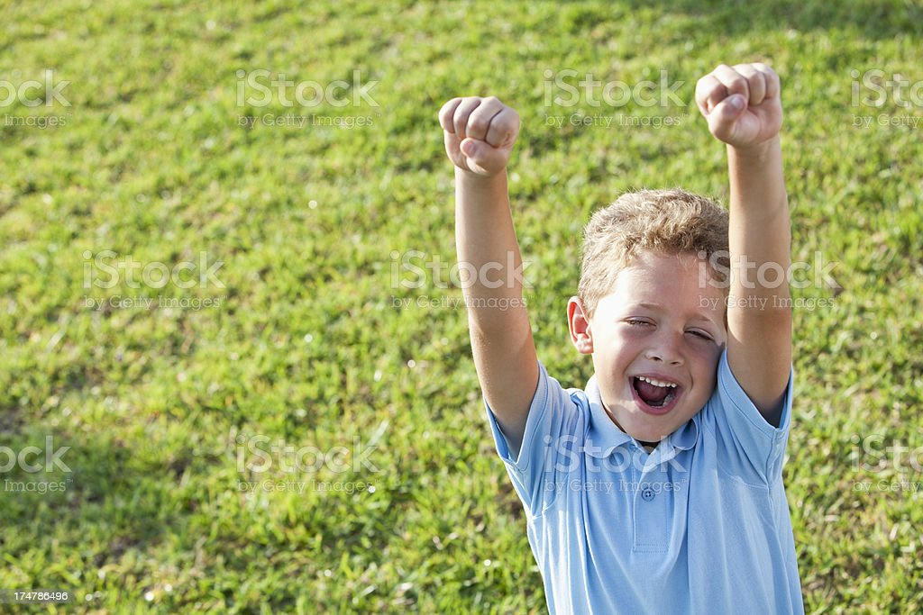 Excited little boy cheering stock photo