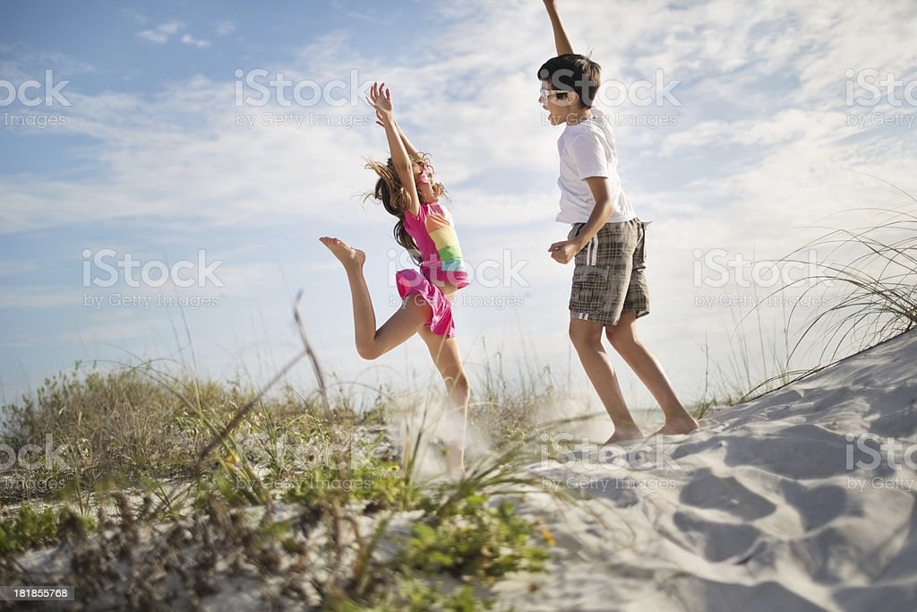 Excited Little Children Jumping On Beach royalty-free stock photo