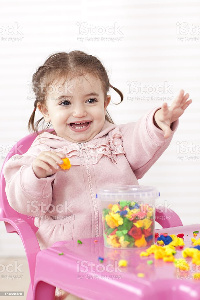 Excited little girl doing activities. royalty-free stock photo