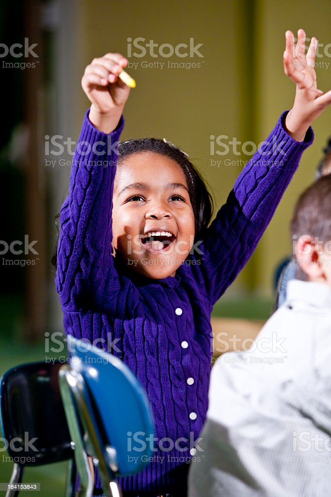 Excited little girl in school stock photo