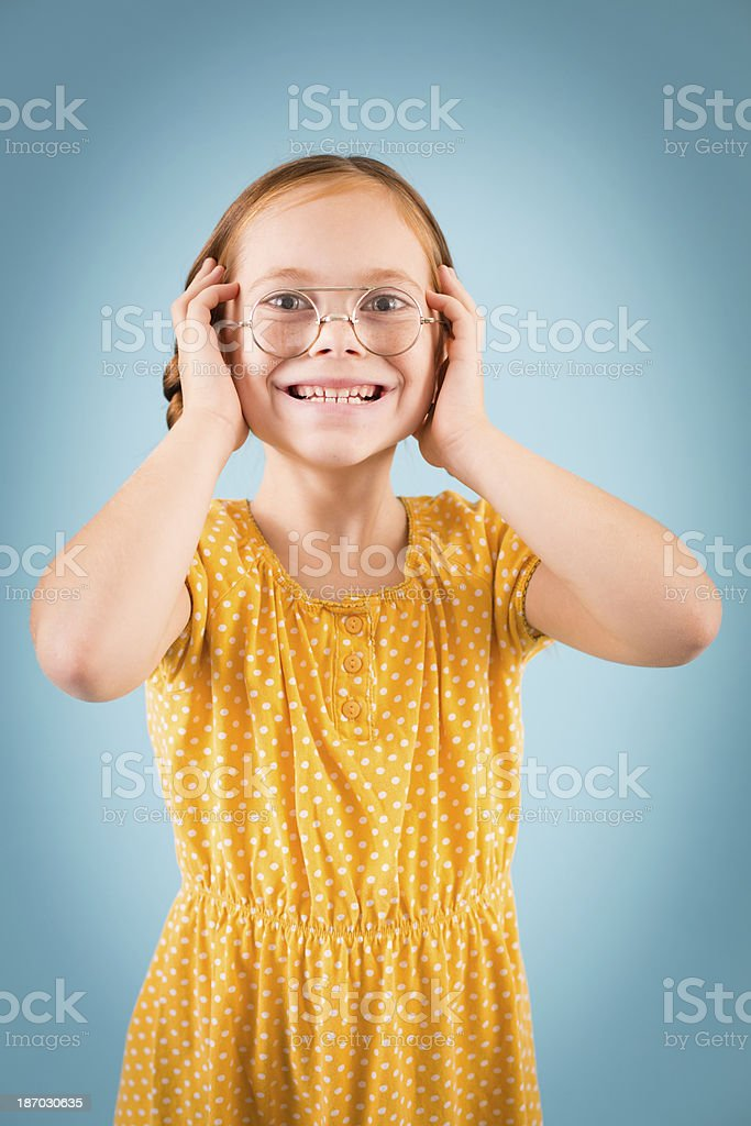 Excited Little Girl Wearing Vintage, Nerdy Glasses royalty-free stock photo